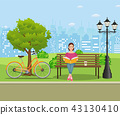 Young woman reading books 43130410