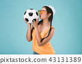 beautiful young woman kissing a football 43131389