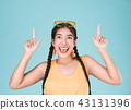 Portrait of a fitness woman pointing fingers up 43131396