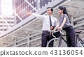 Businessman direction for a bicycle woman 43136054