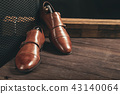 Double strap monk shoes on wooden table 43140064