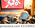 Drone maintenance with spare parts on the table 43150063
