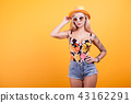 Happy beautiful woman posing in sunglasses and hat 43162291