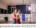 Couple enjoyng dancing kizomba in big studio hall 43162370