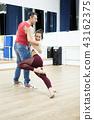 Professional Kizomba dancers showing their performance in big studio hall 43162375