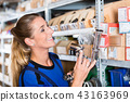 Experienced manual female worker in a sanitary ware shop 43163969