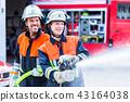 Men of the fire department extinguish fire 43164038