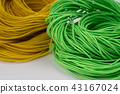 Rope, Colorful rubber rope on a white background. 43167024