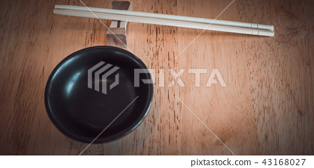 Chopsticks and dipping bowl for soy sauce. 43168027
