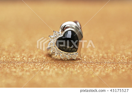 diamond ring and black gemstone 43175527