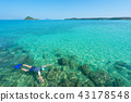 Tourists snorkel in crystal turquoise water 43178548