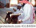 Two religious muslim man praying together inside the mosque 43184004