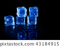 Blue ice cubes reflection on black background. 43184915