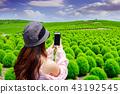 Young woman take a photos  43192545