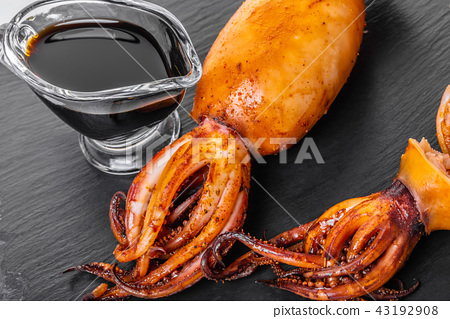 Stuffed squid with soy sauce 43192908