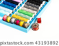 isolated box with bobbins of threads on a white background 43193892