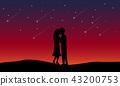 Loving couple kissing among meteor shower 43200753