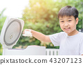 Asian boy and rice cooker 43207123