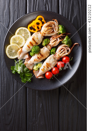 grilled calamari with tentacles with tomatoes 43210212