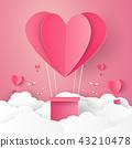 Hot air balloon in a heart shape flying on sky 43210478