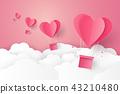 Hot air balloon in a heart shape flying on sky 43210480