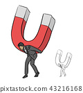 Businessman in suit holding big magnet  43216168