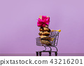 Christmas cookie and gift box inside supermarket cart  43216201