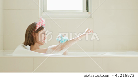 woman wash body in bathtub 43216972