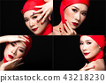 Asian tanned skin woman with strong color red lips 43218230