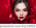 Asian tanned skin woman with strong color red lips 43219002