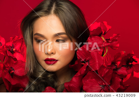 Asian tanned skin woman with strong color red lips 43219009