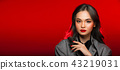 Asian tanned skin woman with strong color red lips 43219031