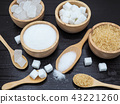 Wooden bowl and spoon with sugar cube  43221260