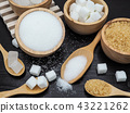 Wooden bowl and spoon with sugar cube  43221262