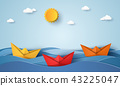 origami boat sailing in blue ocean 43225047