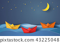origami boat sailing in blue ocean at night 43225048