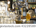 Glass of light beer serving fresh beer on counter 43226589