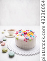 Cake from marzipan flowers macaroons and coffee. 43236054