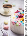 Cake from marzipan flowers macaroons and coffee. 43236055