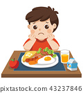 Little boy unhappy to eat breakfast. 43237846