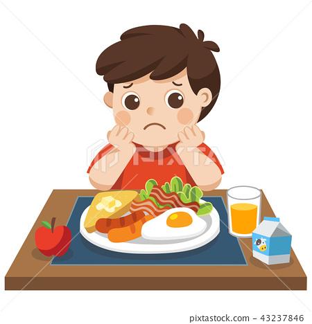 Little boy unhappy to eat breakfast. 43237846