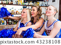 Group of cheerleader girls watching a game of their favorite tea 43238108