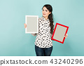 Young woman with two blank frames 43240296