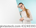 Attractive young woman with blank banner 43240393