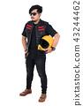 biker man in black leather jacket holding helmet 43244462