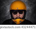 close up of biker man in motorcycle helmet  43244471