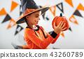 happy   child girl in pumpkin costume to halloween. 43260789