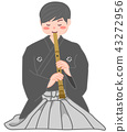 A male blowing a shakuhachi 43272956