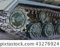 Iron caterpillars of Russian tank ride on asphalt 43276924