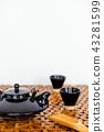 Closeup of tea set on white background 43281599
